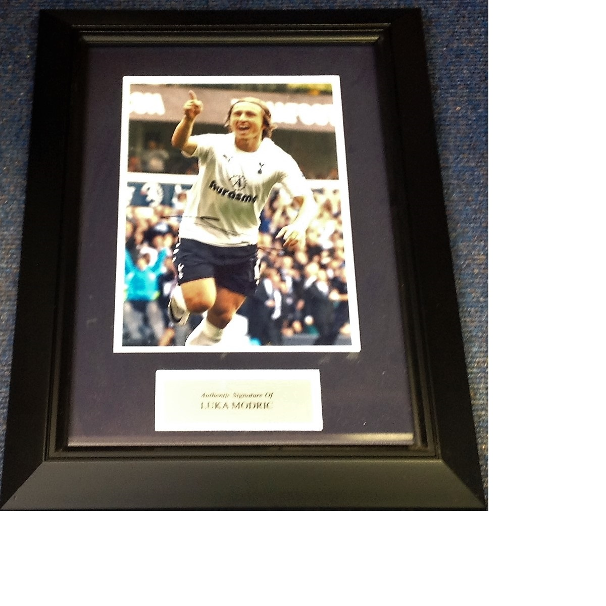Lot 45 - Football Luka Modri 21x14 approx framed and mounted signed colour photo pictured during his time