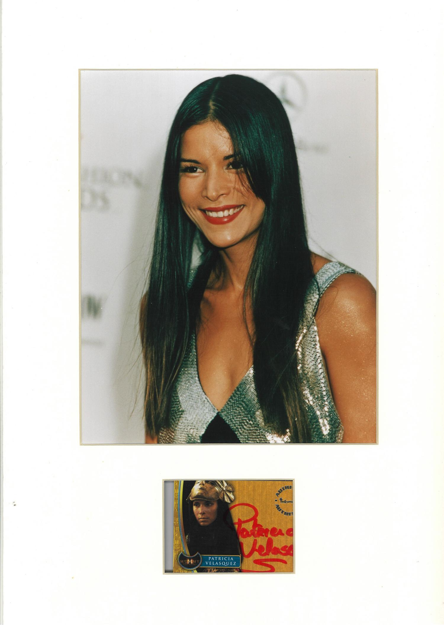 Lot 140 - Patricia Velasquez signature piece mounted below colour photo. Approx overall size 16x12. Good