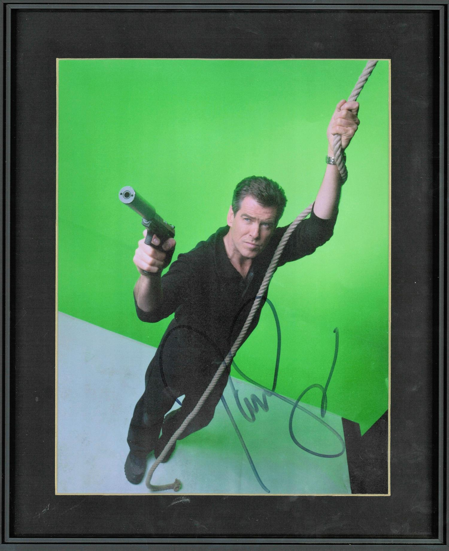 Lot 131 - Pierce Brosnan signed colour photo. Mounted and framed to approx 14x12. Good Condition. All signed