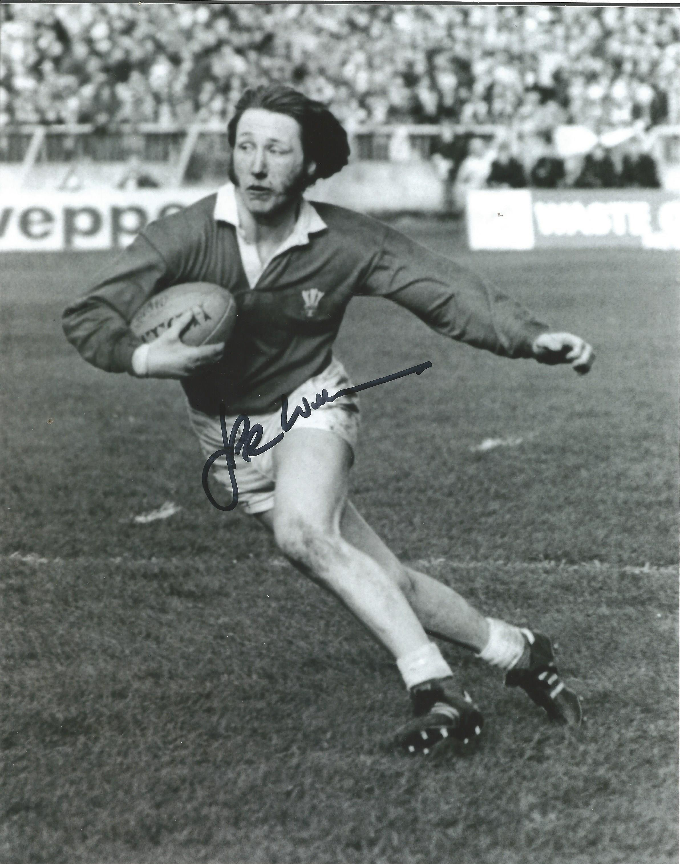 Lot 403 - Rugby Union JPR Williams 10x8 signed b/w photo pictured in action for Wales. John Peter Rhys