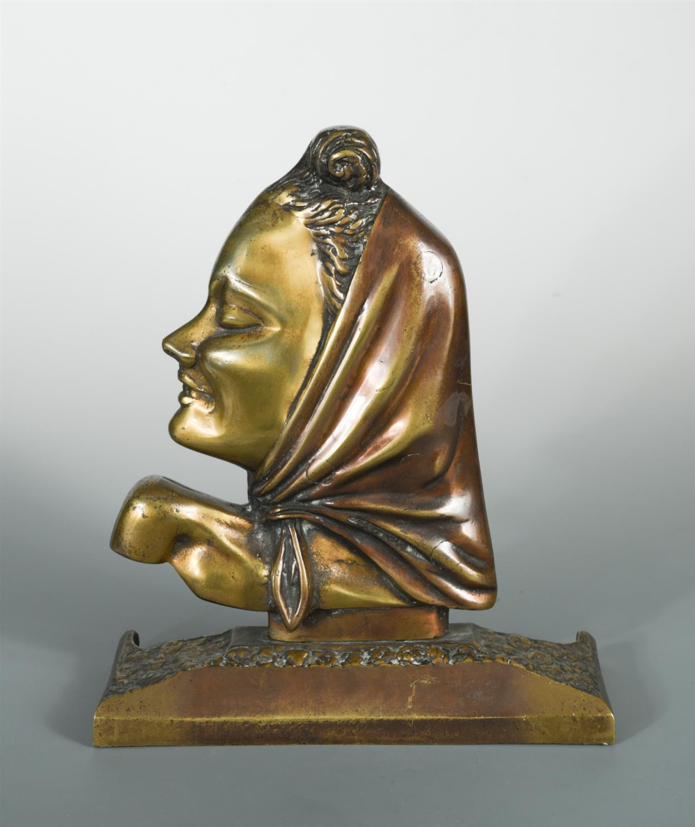 Lot 6 - A patinated and gilt bronze female head in profile, cast wearing a head scarf and mounted to a