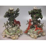 Lot 19 - A pair of Continental 19th century candlestick bases, modelled on stories from Aesop's fables,