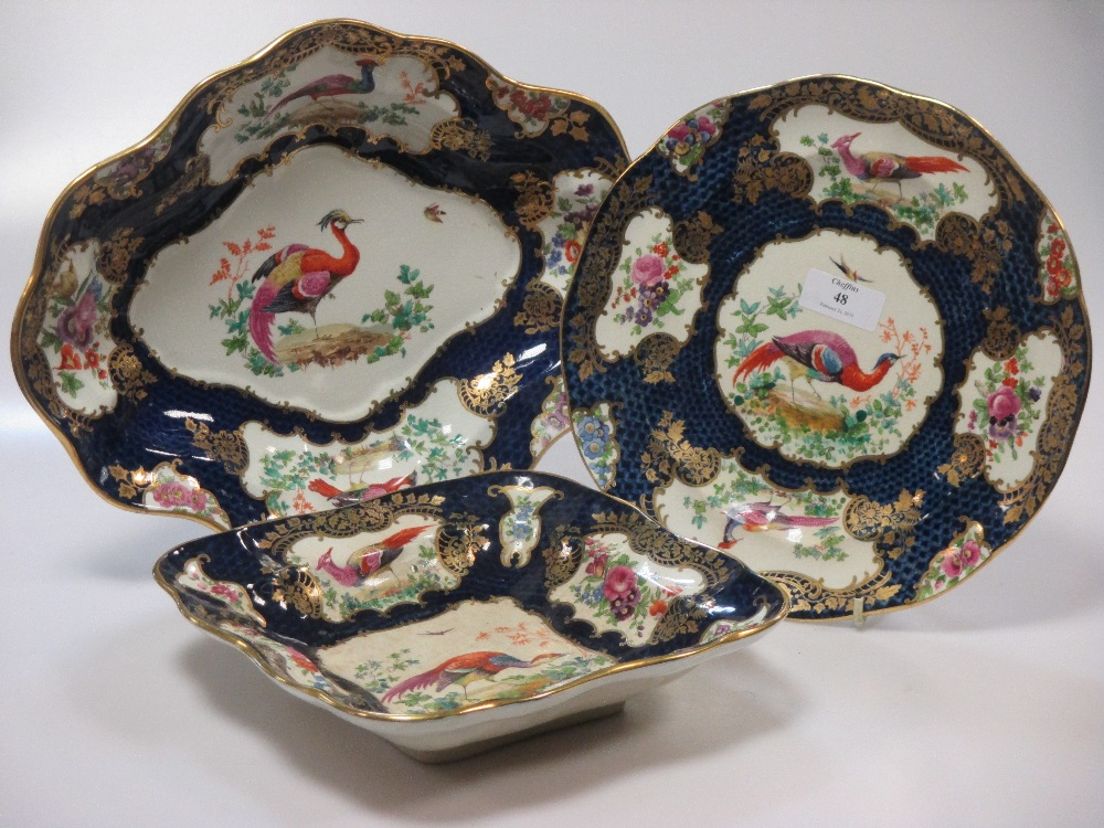Lot 48 - A Booth's dinner service, decorated in 18th century Worcester style with blue scaled panels and
