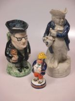 Lot 45 - A treacle glazed toby jug, character mug and a character bottle; other 19th century toby jugs (8)