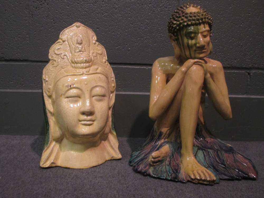 Lot 59 - A pottery figure of Buddha and a ceramic head of Buddha