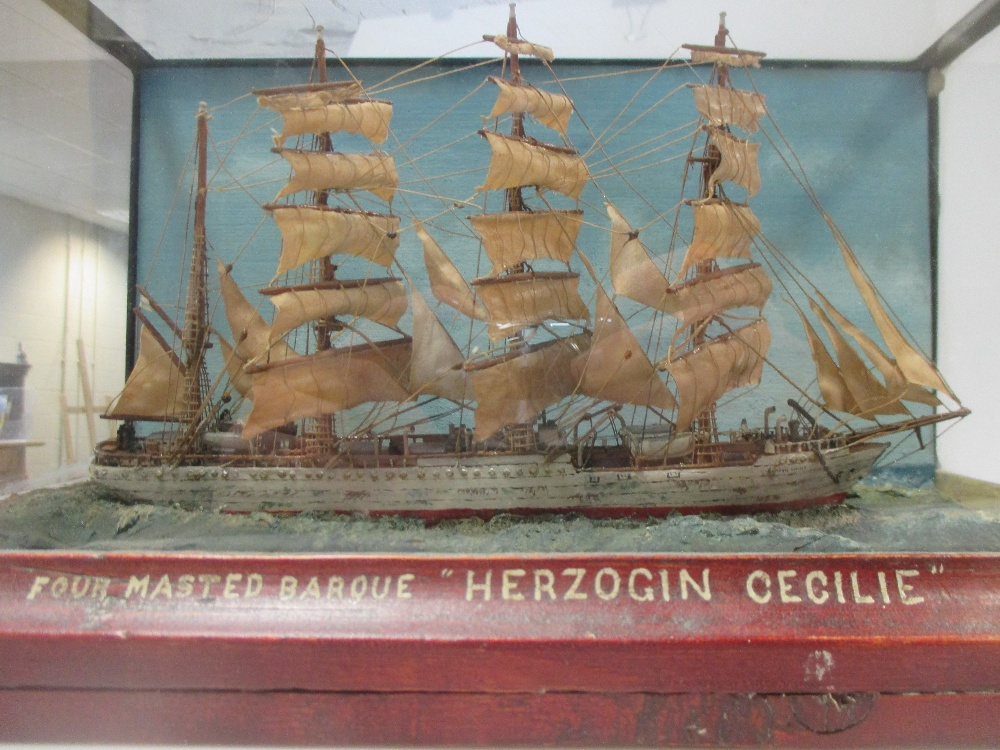 Lot 32 - A cased model of a four masted barque 'Herzogin Cecilie' together with a print of HMS Swiftshore,