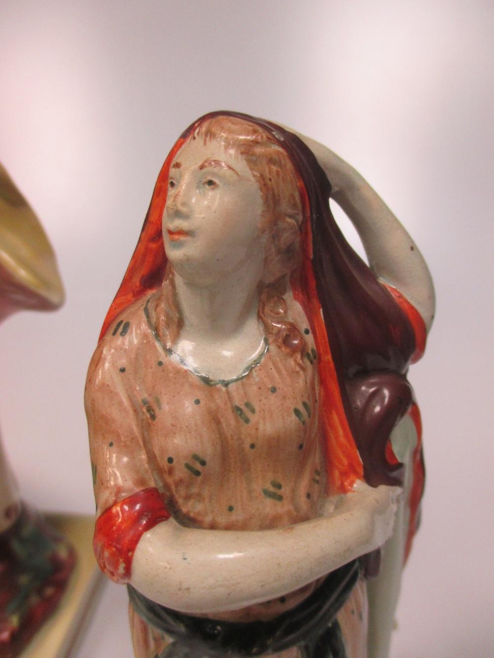 Lot 26 - A Walton pearlware figure of a lady archer, a Staffordshire pearlware figure of 'Plenty', two