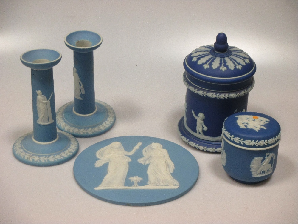 Lot 14 - Items of Wedgwood blue jasperware to include a circular plaque, a pair of candlesticks, jugs etc