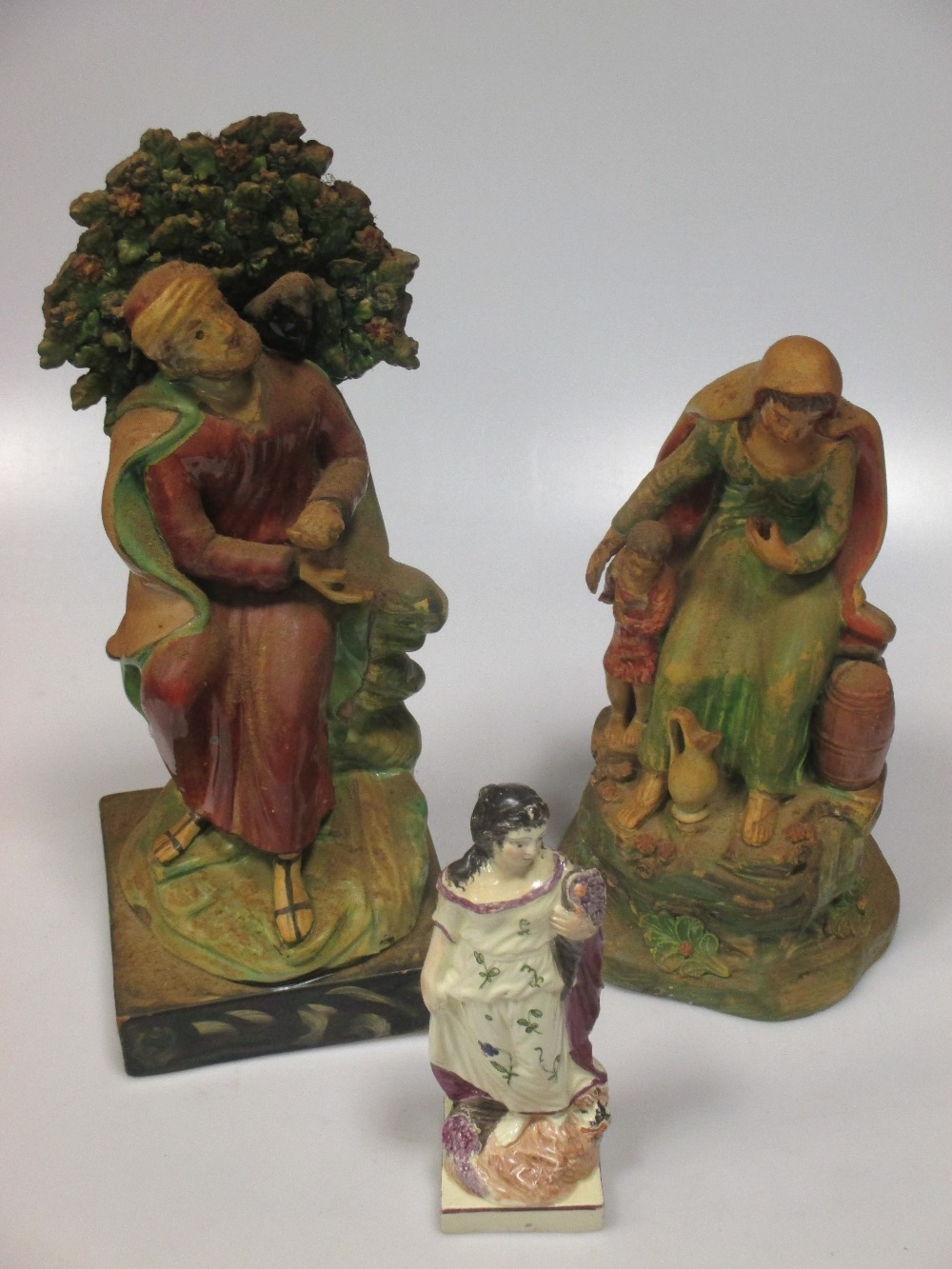 Lot 9 - A Staffordshire figure group of Elijah, a pearlware figure emblematic of 'Winter', seven other