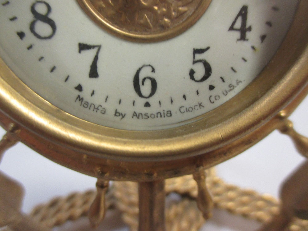 Lot 1 - A late 19th century French gilt metal timepiece, on a tripod stand, 34cm high