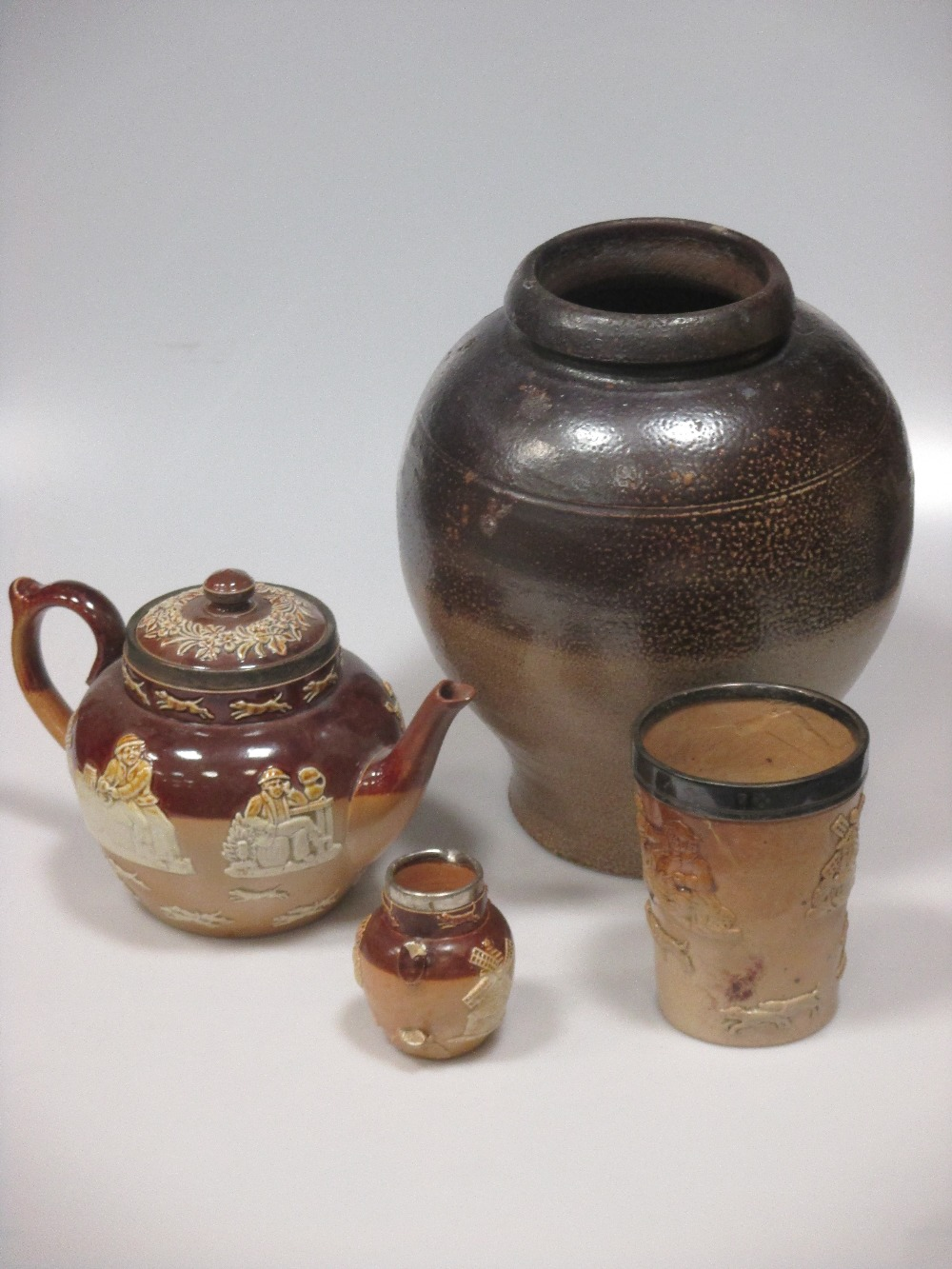 Lot 11 - An 18th century stoneware bellarmine jug (A/F), saltglazed pottery to include a jug, large jar and