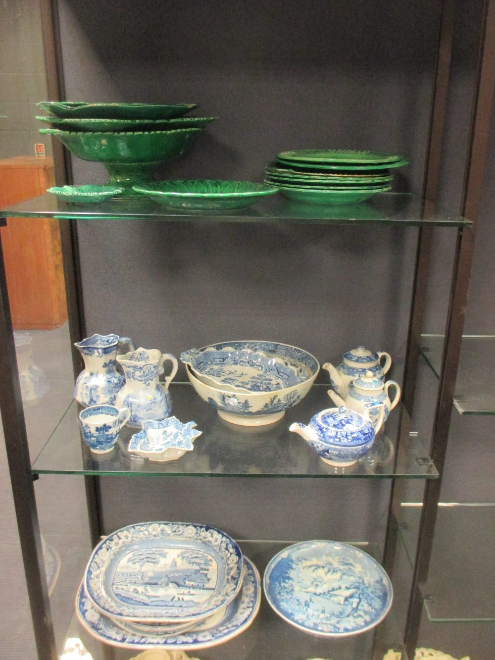 Lot 52 - A collection of blue and white pottery to include a cheese stand, bowl and jugs, pearlware miniature