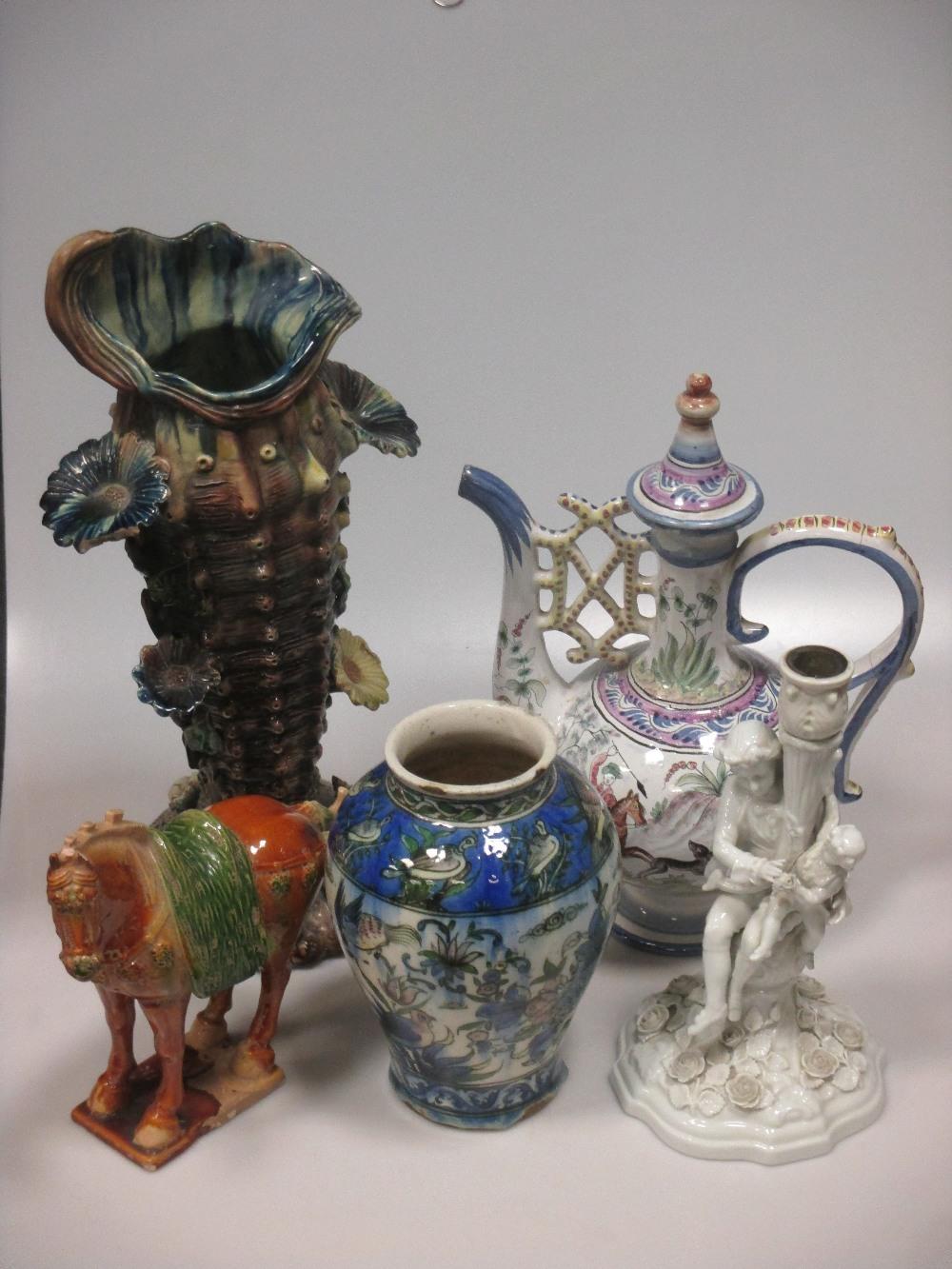Lot 23 - A Persian vase, a Portuguese Persian style ewer, a Sitzendorf white glazed figural candlesticks,