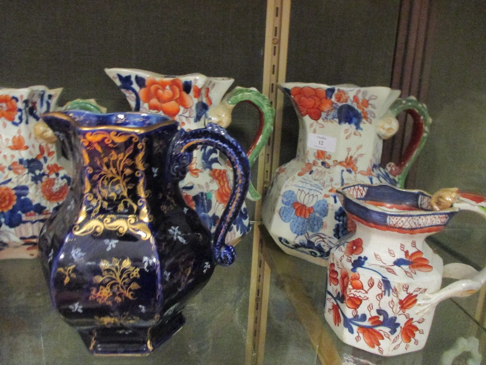 Lot 12 - A collection of Masons Imari ironstone to include jugs, two tureens , covers and stands