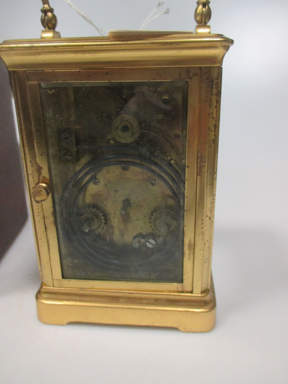 Lot 18 - A French carriage clock, typical shape case, dial (cracked) painted with a lake scene, gong striking