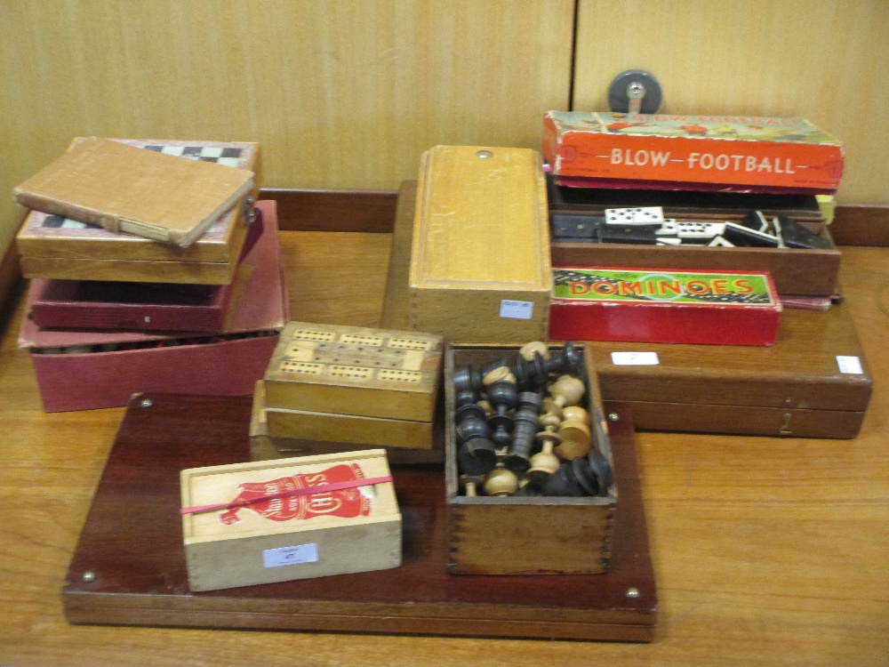 Lot 47 - A collection of 20th century board games to include blow football, chess boards, dominoes