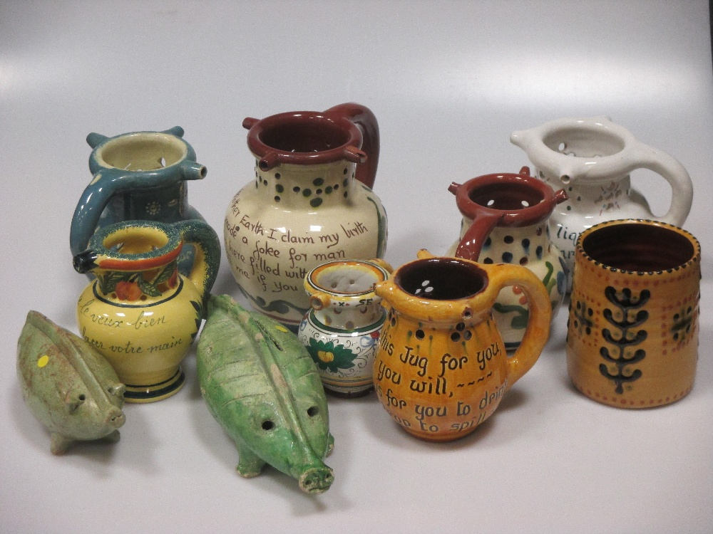 Lot 4 - A Bideford pottery puzzle jug and other items of Barnstaple pottery; a collection of unusual green