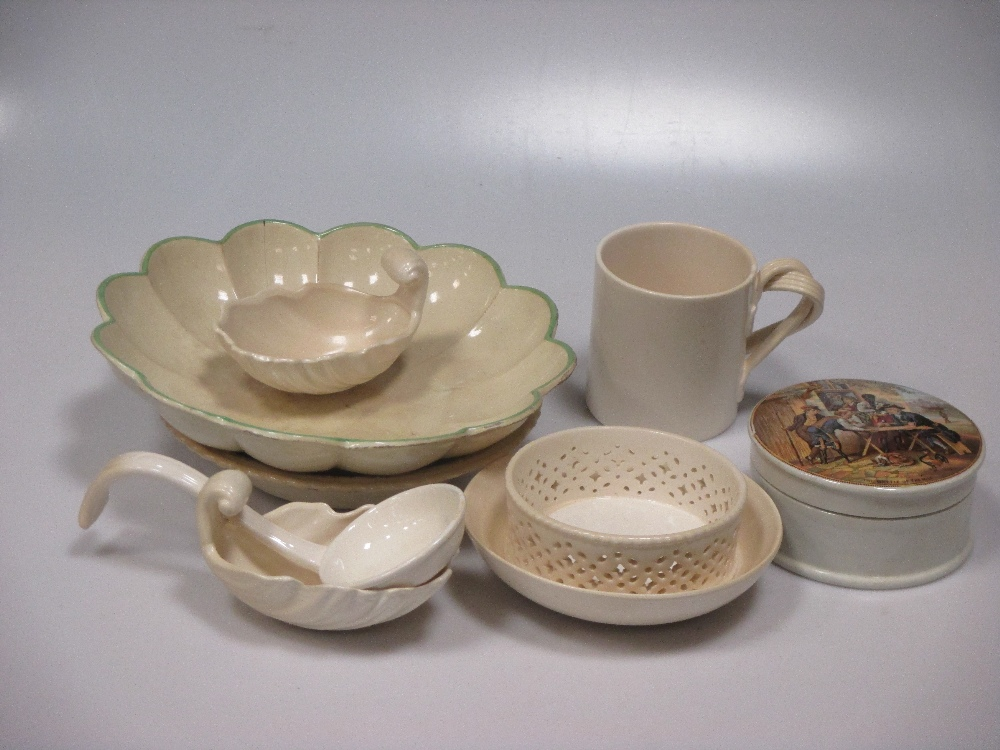 Lot 51 - A collection of 18th century and later creamware, to include a melon tureen and cover, crested