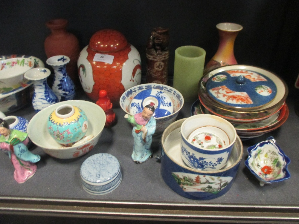 Lot 28 - A large quantity of mixed Asian ceramics to include blanc de Chine, a ginger jar, a teapot etc