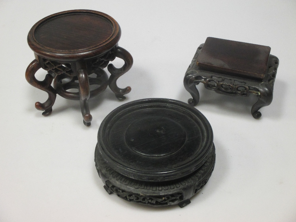 Lot 37 - A large collection of Chinese hardwood vase stands