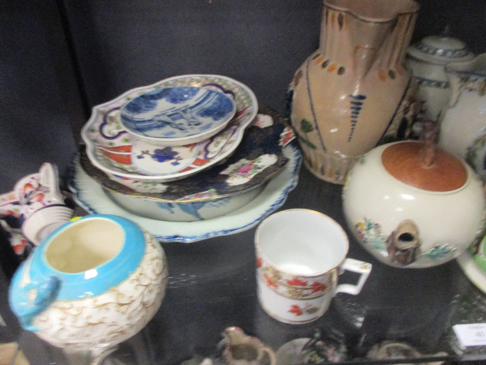 Lot 41 - A collection of English pottery jugs to include prattware jugs and a mercury jug