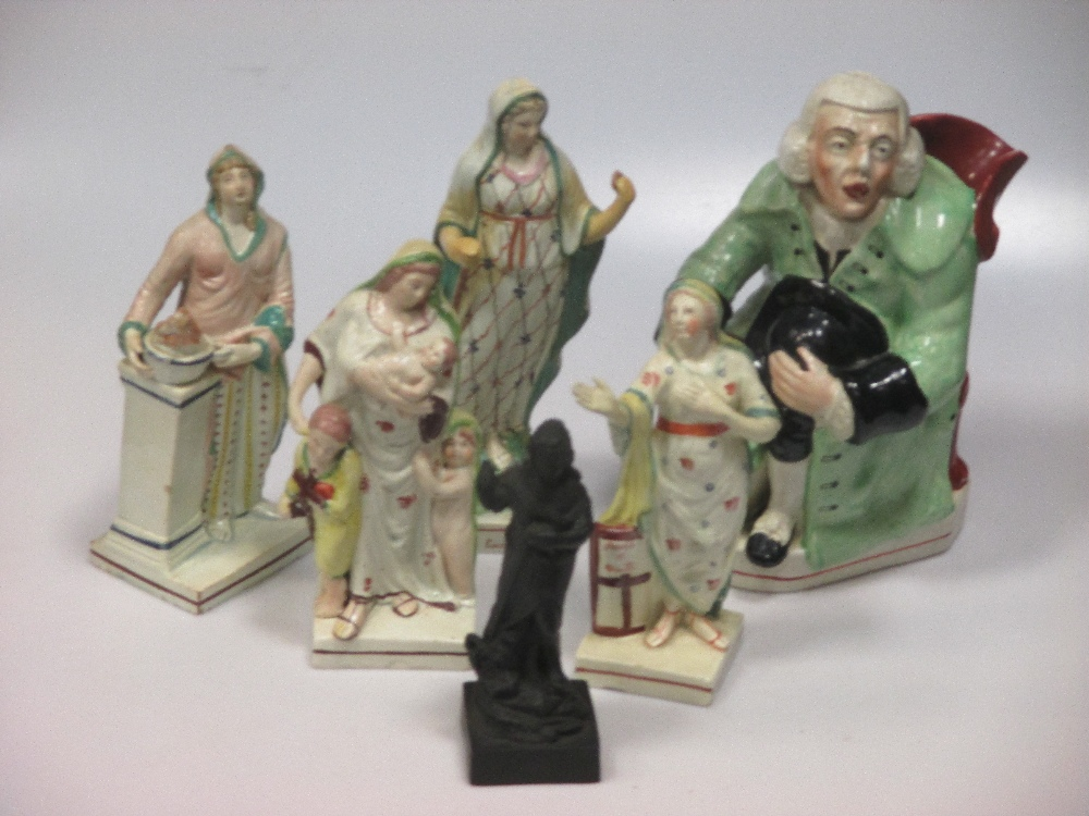 Lot 3 - A Staffordshire figure group of the 'Drunken Vicar and the Clerk', a 19th century jug modelled as