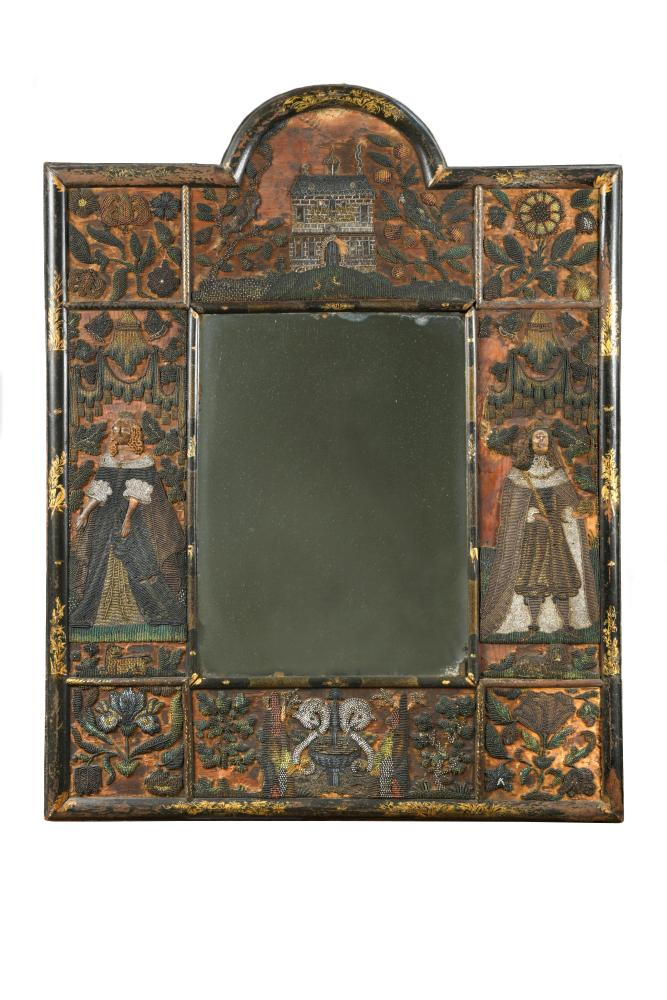 A Charles II beadwork mirror frame, of arched outline, the rectangular mirror plate enclosed by a
