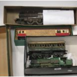 Lot 194 - Tinplate 0 gauge model trains: Bing 1st / 3rd carriage SR, 2 Bassett Lowke boxes contining a BR