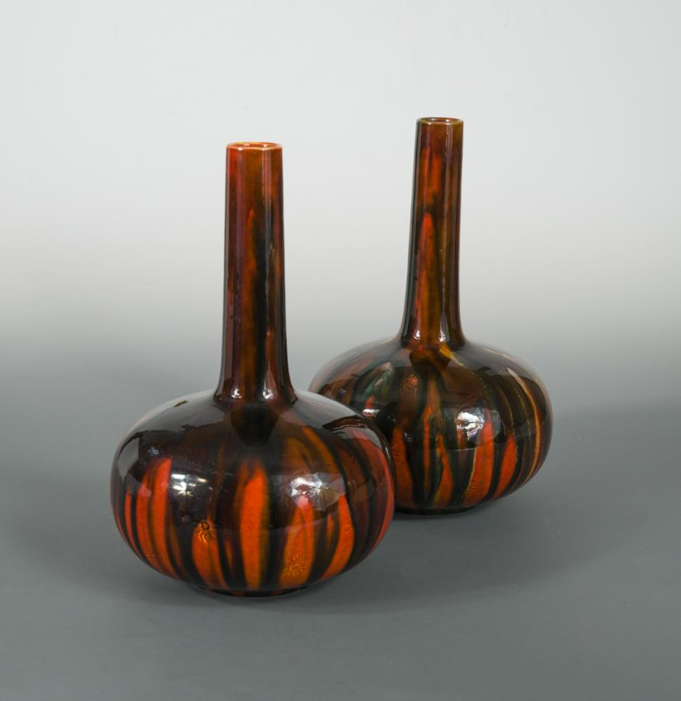 Lot 21 - A pair of Burmantofts bottle vases, possibly designed by Dr Christopher Dresser, each with incised