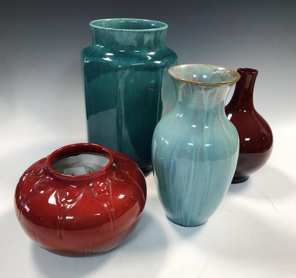Lot 26 - Four Pilkington's Lancastrian vases, the first of bottle form with red lustre glaze, another of