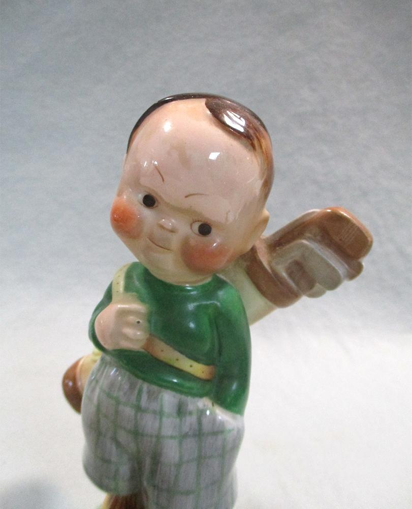 Lot 54 - A Shelley Mabel Lucie Atwell model of 'The Golfer', painted in colours, printed and painted marks