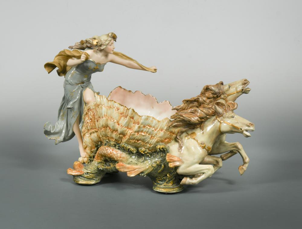 Lot 33 - An Amphora polychrome painted porcelain figural dish, modelled as a classical female riding a