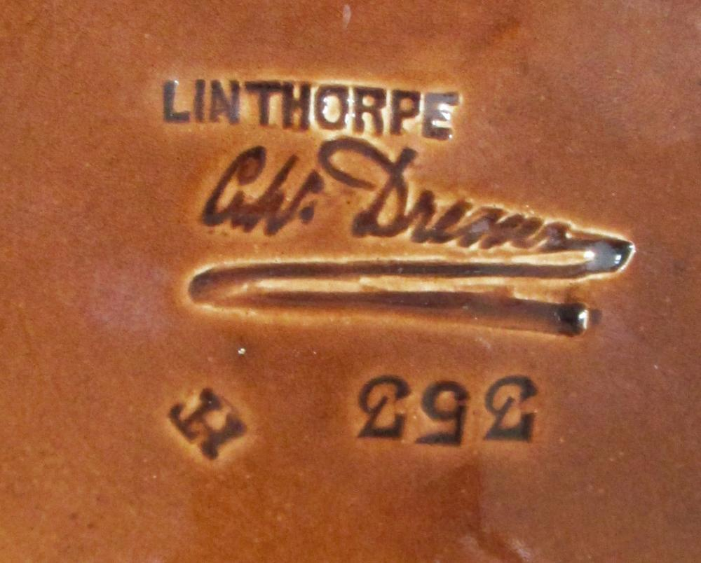Lot 24 - Dr. Christopher Dresser (1834-1904) for Linthorpe, a small plate, glazed in mottled greens and