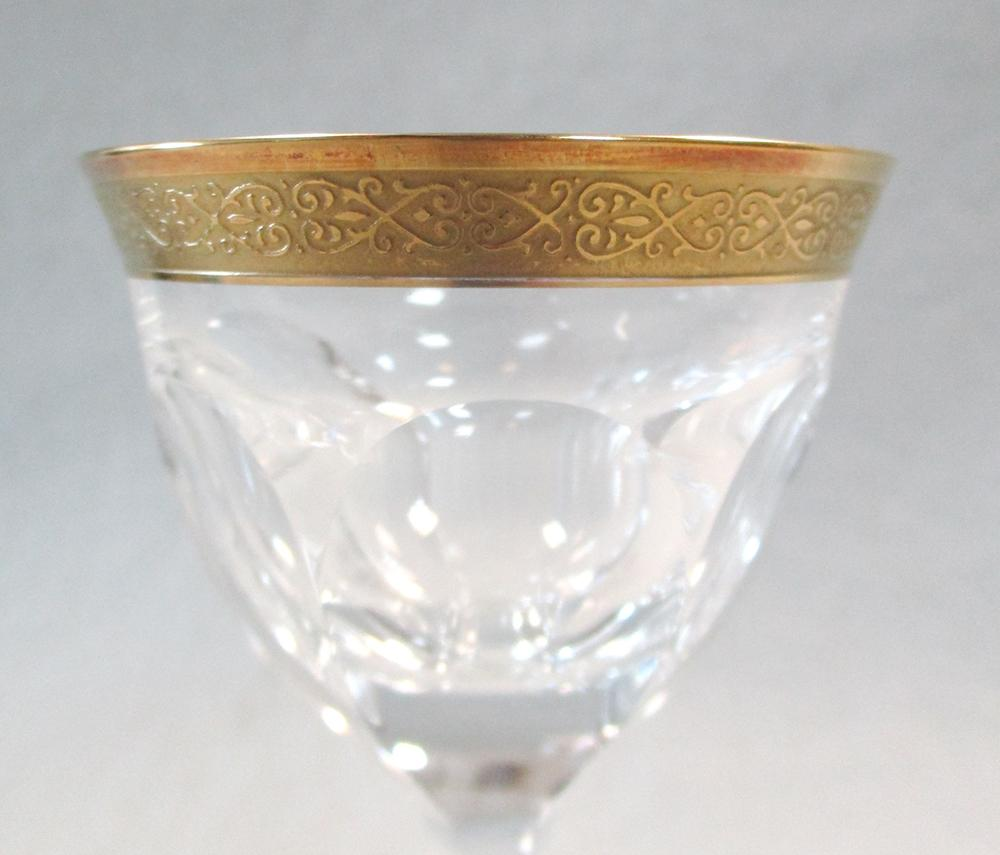 Lot 12 - A set of eight Moser Lady Hamilton pattern liqueur glasses, the facetted bowls with gilt rims,