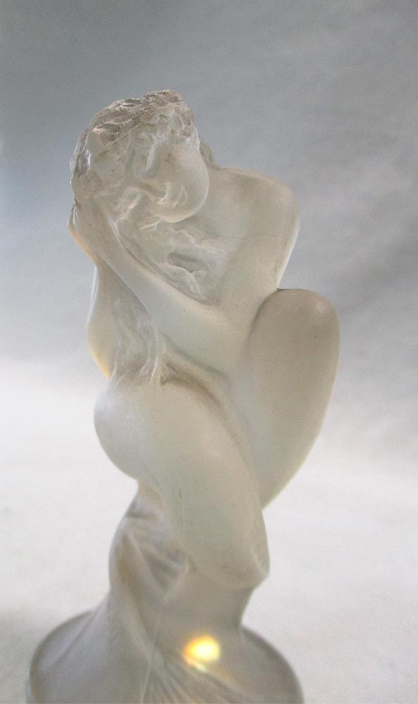 Lot 6 - Sirene, a rare R. Lalique opalescent glass car mascot, the glass figure with moulded signature and