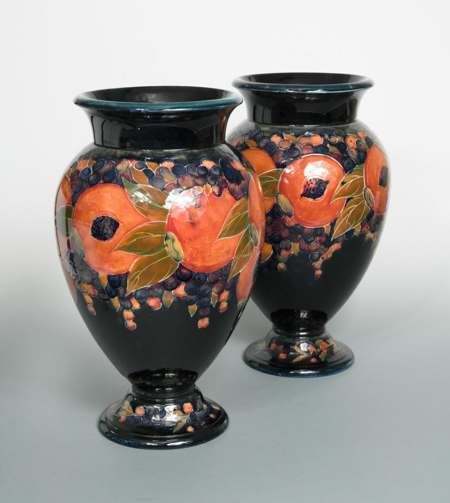 Lot 41 - A particularly large pair of Moorcroft Pomegranate pattern vases, of inverted baluster form with