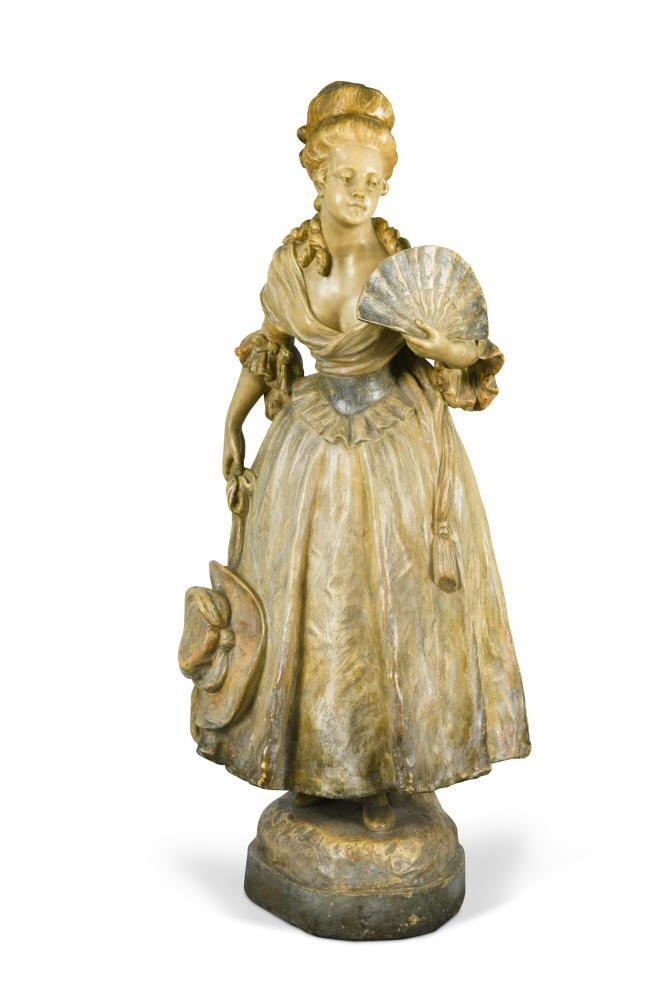 Lot 29 - A Goldscheider Art Nouveau cold painted pottery figure of a young woman, modelled in 18th century