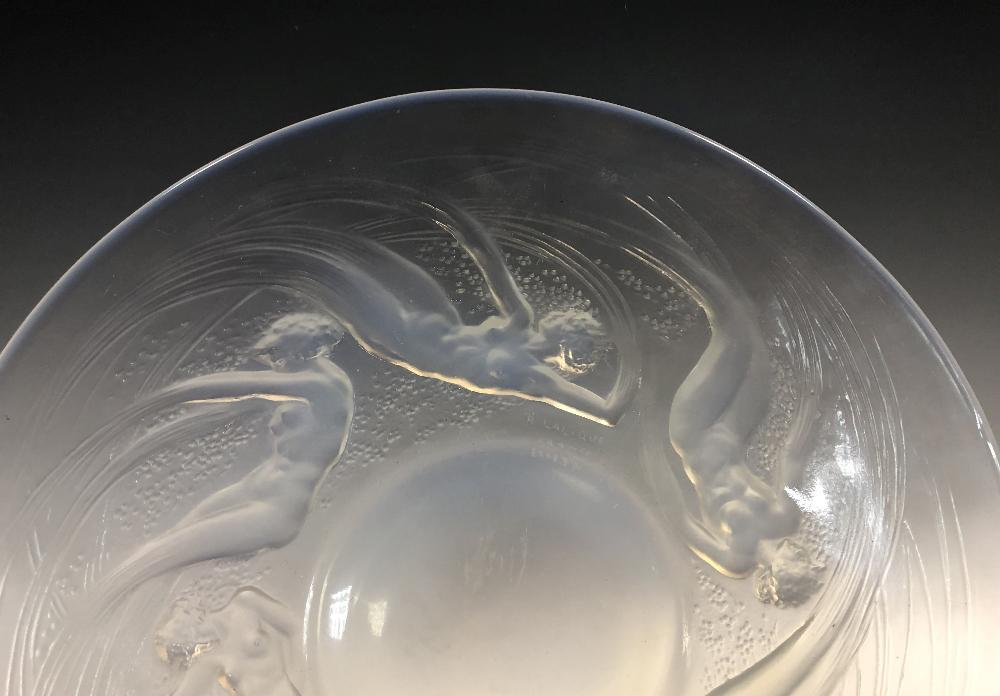 Lot 8 - Ondines, an R. Lalique opalescent glass plate, of circular form moulded with a band of swirling