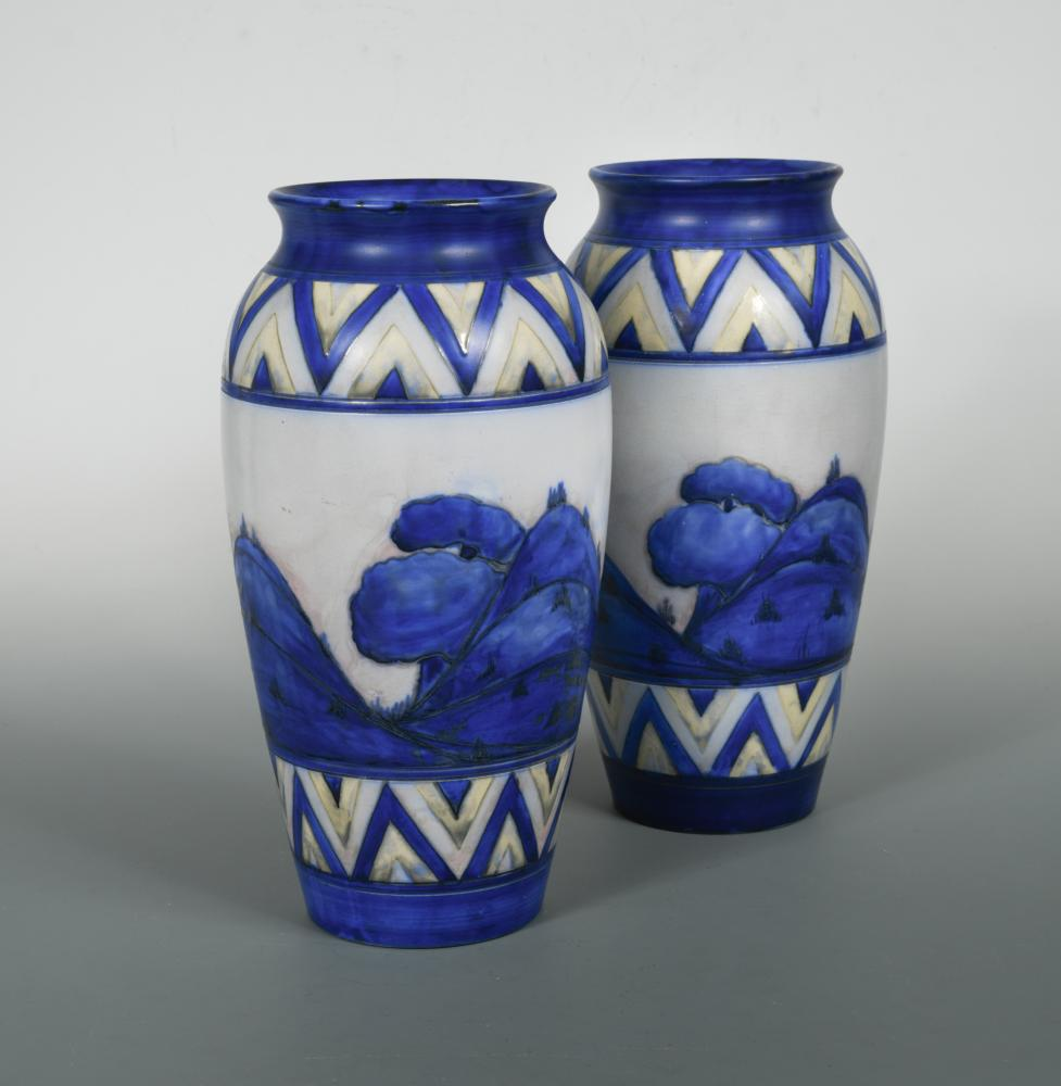 Lot 42 - A pair of early Moorcroft Dawn Landscape pattern vases, painted between chevron borders, painted and