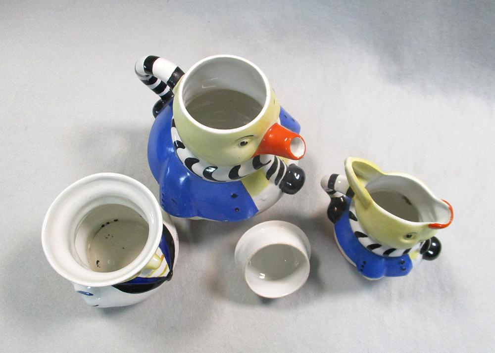 Lot 57 - A Shelley Mabel Lucie Atwell three-piece nursery set, comprising teapot and cover, milk jug and