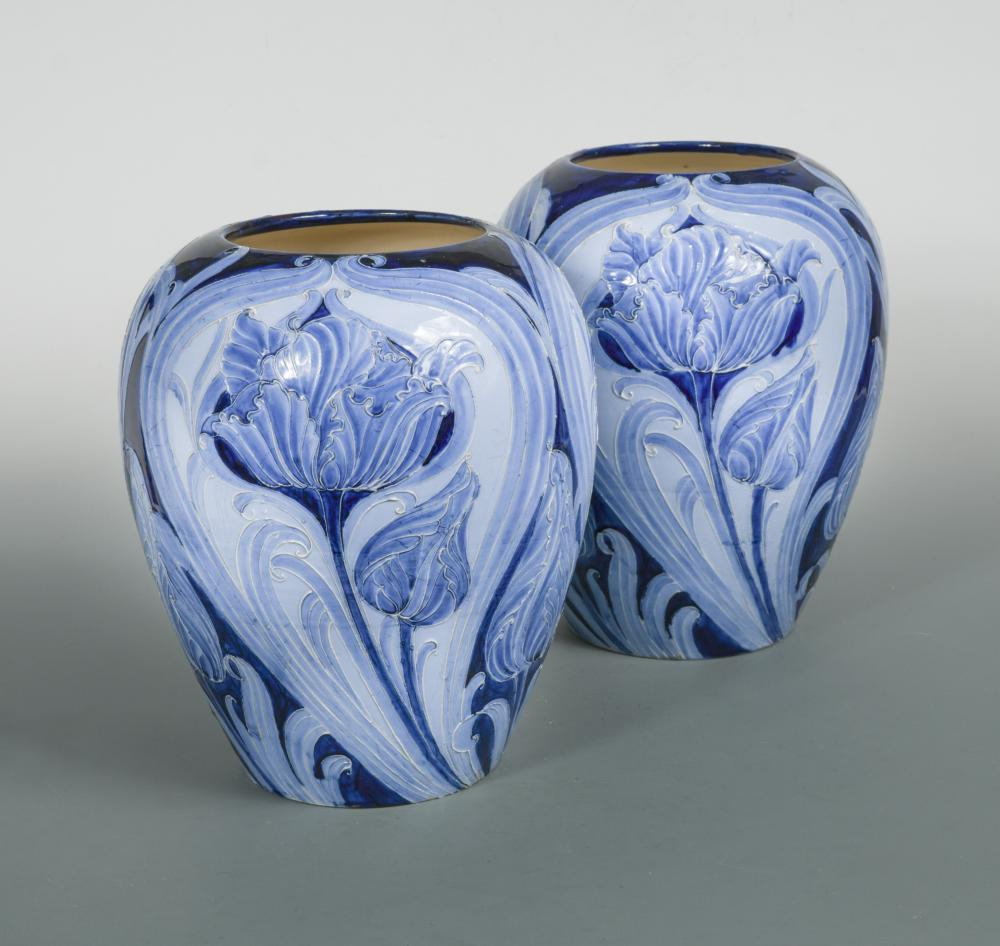 Lot 40 - A large pair of early Moorcroft Florian Ware Tulip pattern vases, circa 1900, decorated in shades of