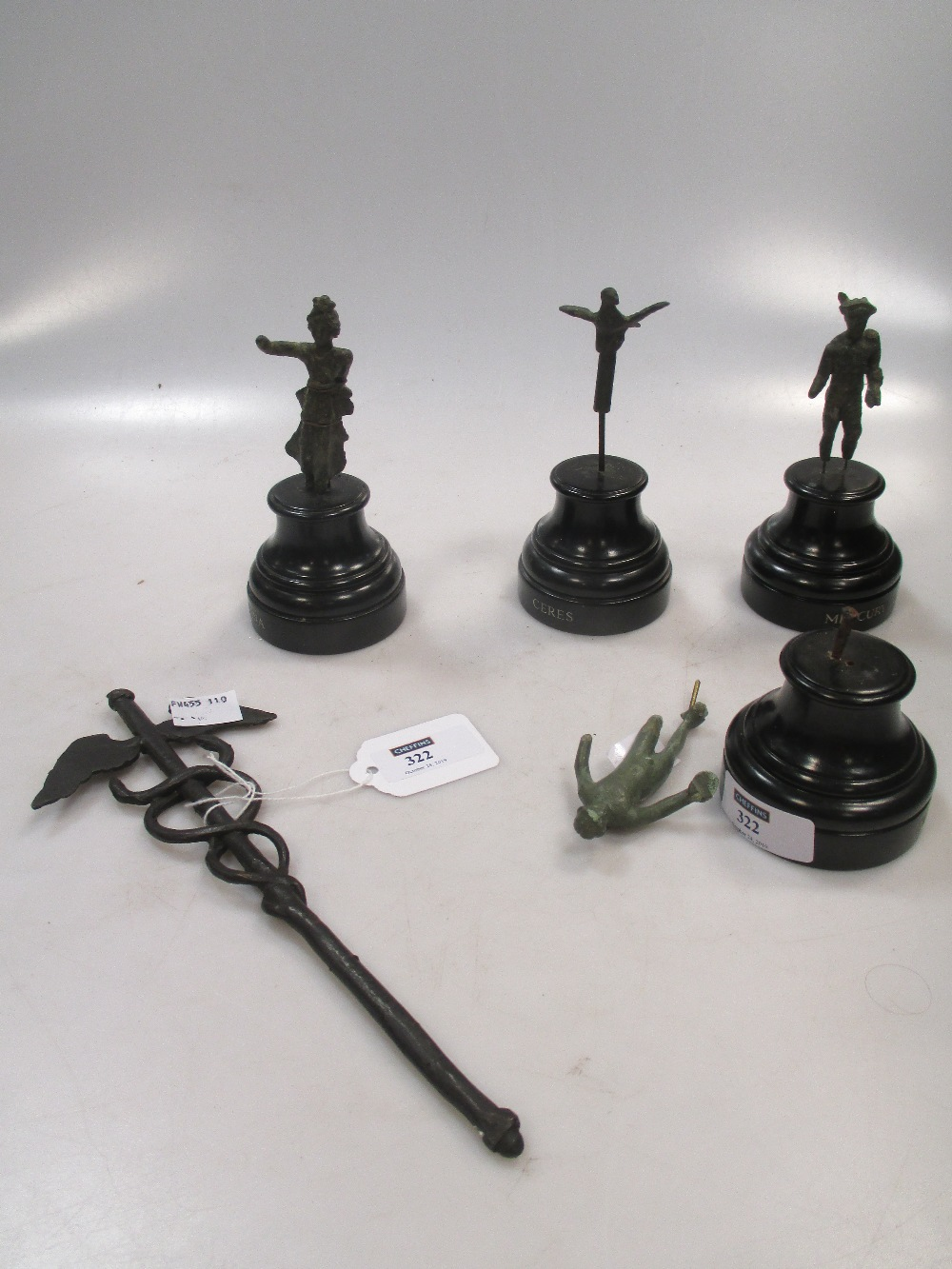 Lot 322 - A Roman bronze figure of Mercury 6cm high together with two similar figures, an eagle, a snake