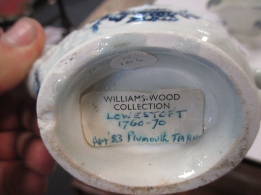 Lot 231 - A Lowestoft porcelain blue and white cream jug together with two other Lowestoft cream jugs (3)