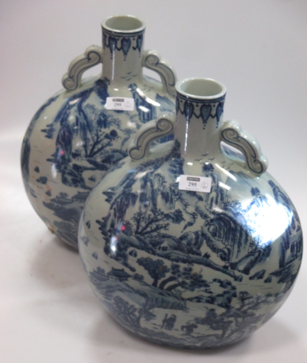Lot 295 - A pair of Oriental blue and white moon flasks (2)