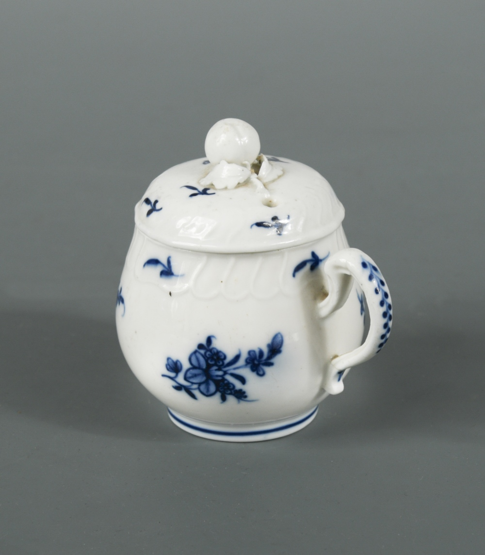 Lot 262 - A Tournai blue and white baluster custard cup and cover, circa 1780, decorated with floral sprays