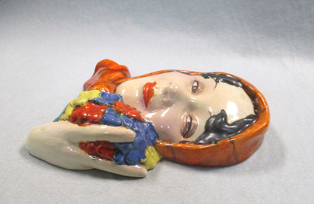 Lot 205 - Three Art Deco Goebel wall masks, two in painted terracotta, the other in painted plaster, impressed