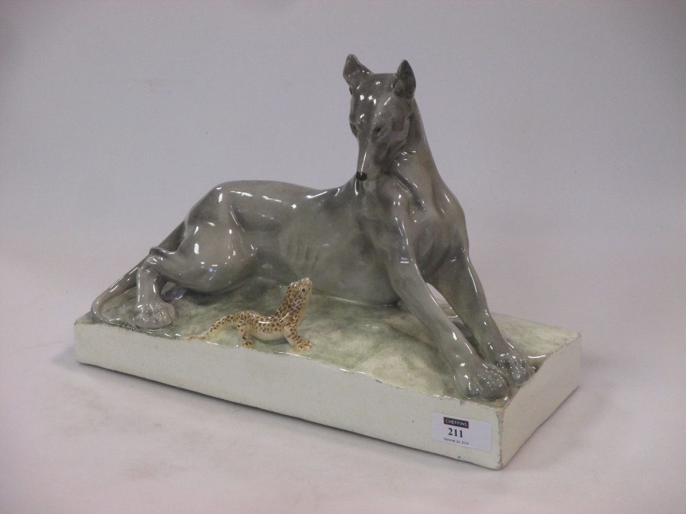 Lot 211 - A Continental Goldscheider style model of a dog & a lizard