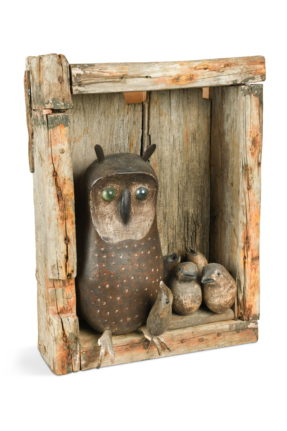 Lot 246 - In the manner of Guy Taplin, a carved and painted wood model of an Owl feeding her chicks, set in an