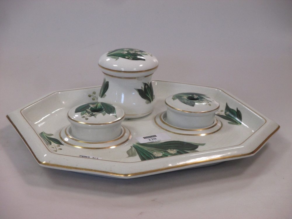Lot 220 - A Belleek pearlware desk set, decorated with 'Lily of the Valley', 27cm wide