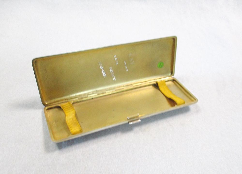 Lot 325 - An Edward VIII silver and enamel Art Deco cigar case,